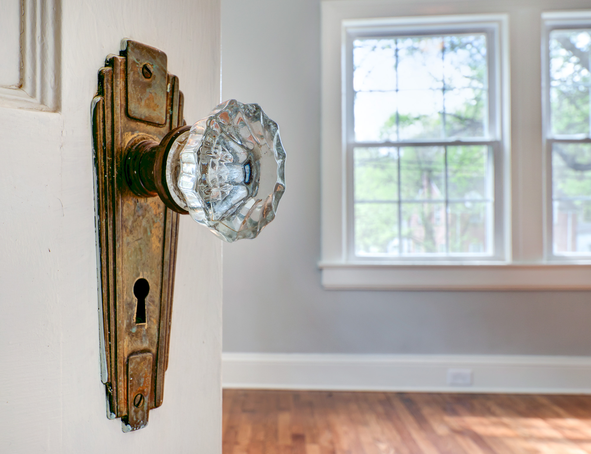 Real Estate Photography: Lovely glass door knobs were retained in this thoughtful renovation.