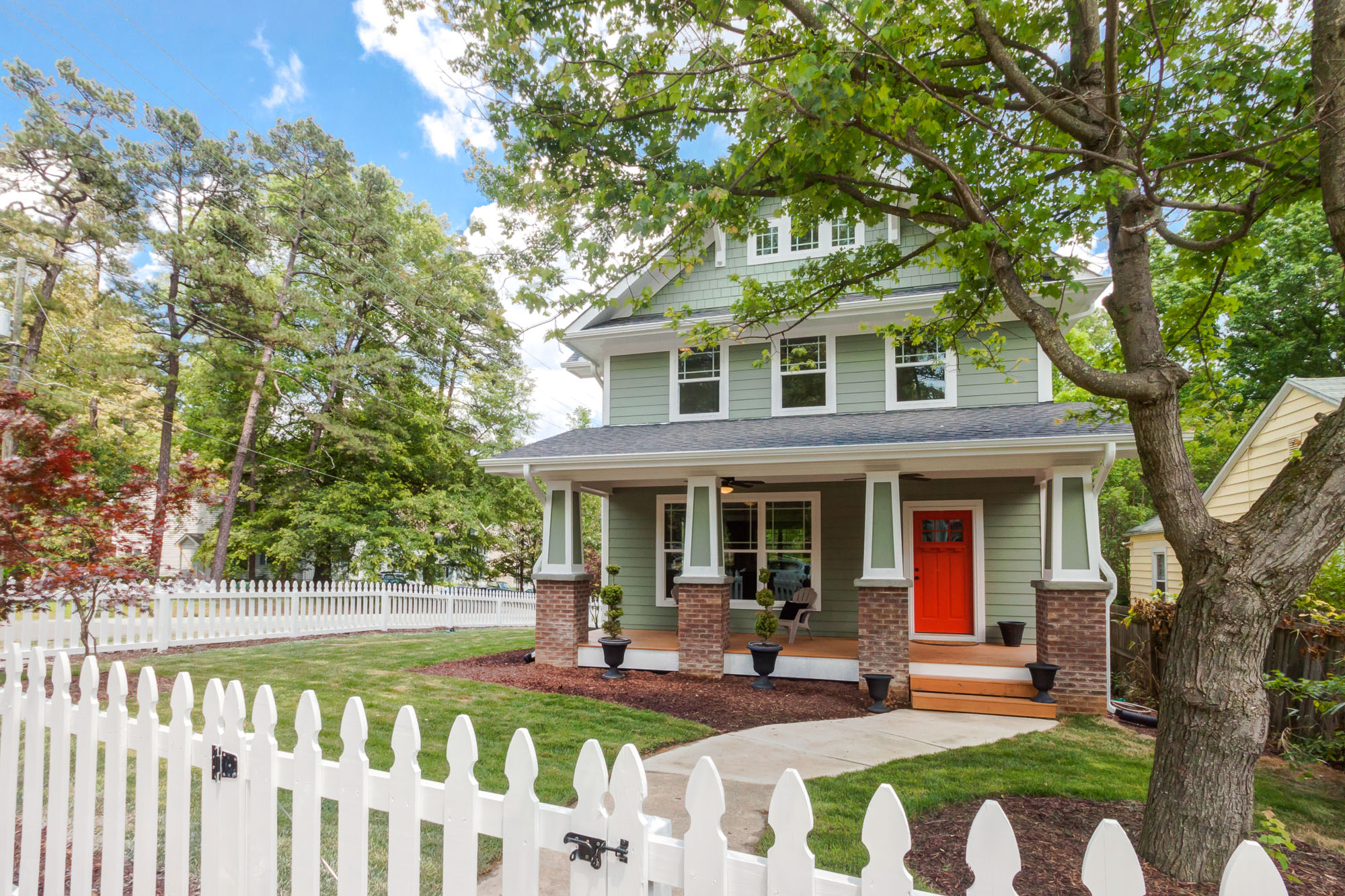 Real Estate Photography: A white picket fence surround this craftsman two story home in Durham, NC